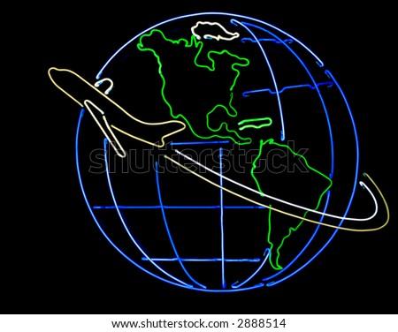 Airplane flying around globe on a black background - stock photo