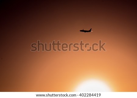 Airplane flying at sunset in Mallorca, Spain