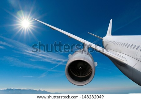 airplane flying down. against the sky.  landing or crash of airplane - stock photo