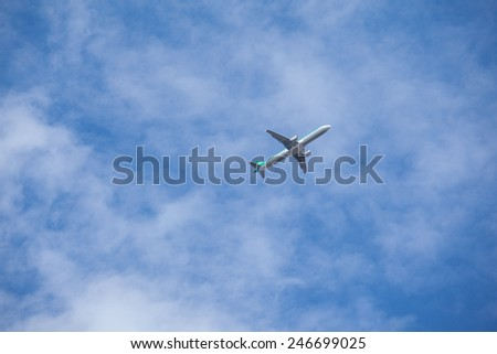 Airplane flying in the blue sky - stock photo