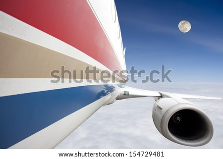 airplane flying in the blue sky freely - stock photo