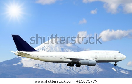 Airplane flying in the sky with beautiful sunlight and Fuji mountain background. - stock photo