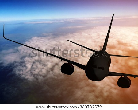 Airplane flying on air in the sky at sunset - stock photo