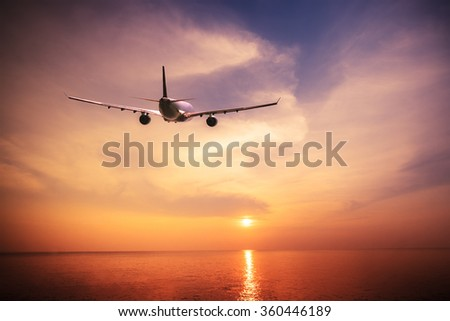 Airplane flying over amazing tropical ocean at  sunset. Thailand travel  landscapes and destinations  - stock photo