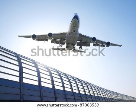 Airplane flying over highway - stock photo