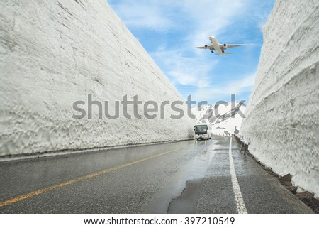 Airplane flying over Tateyama Kurobe Alpine Route, Toyama Prefecture, Japan - stock photo