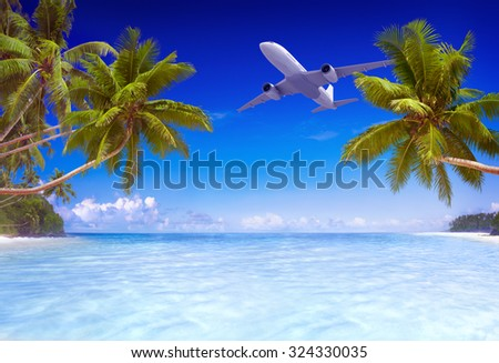 Airplane Flying Over Tropical Beach Travel Concept - stock photo