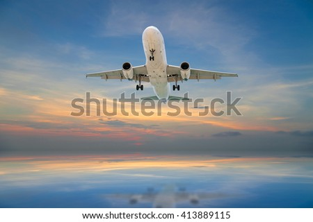 Airplane flying tropical sea at sunset time - stock photo