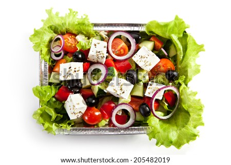 Airplane Food - Greek Salad. Isolated over White - stock photo