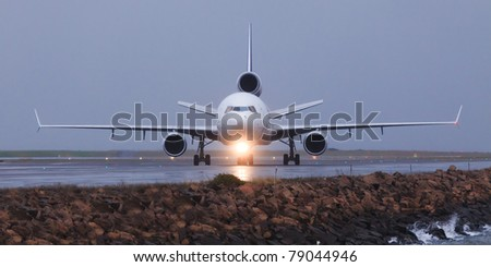 airplane head front view on the land airport runway sea Sydney boeing - stock photo