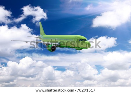 Airplane in a sky with clouds. - stock photo