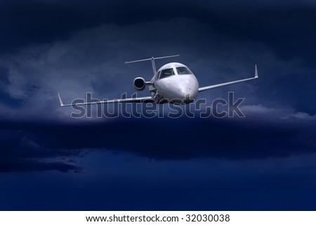 airplane in air on blue dark sky - stock photo