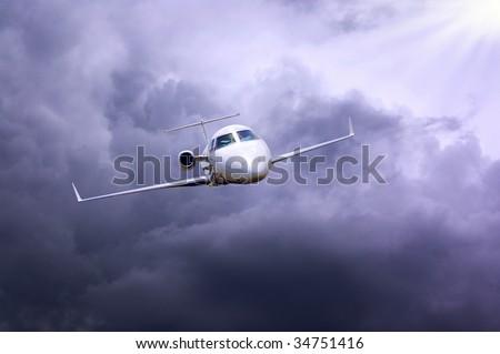 airplane in air on dark blue sky - stock photo