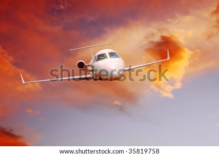 Airplane in air on sunrise sky - stock photo