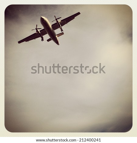 Airplane in clouds with instagram effect - stock photo