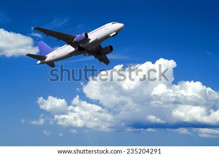airplane in flight over cloudy sky - stock photo