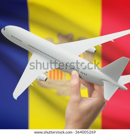 Airplane in hand with national flag on background series - Andorra - stock photo