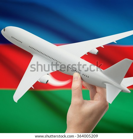 Airplane in hand with national flag on background series - Azerbaijan - stock photo