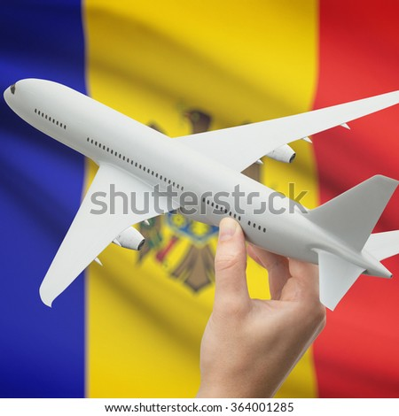 Airplane in hand with national flag on background series - Moldova - stock photo