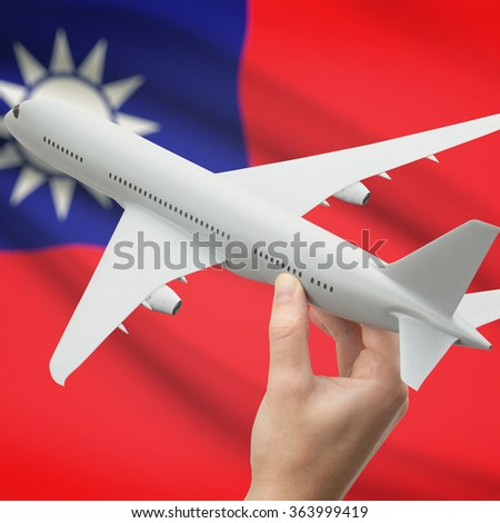 Airplane in hand with national flag on background series - Republic of China - Taiwan - stock photo