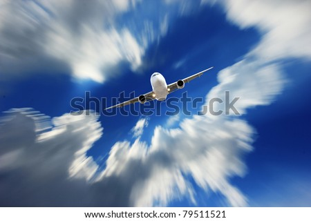 Airplane in motion - stock photo