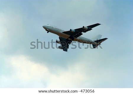 Airplane in overcast - stock photo