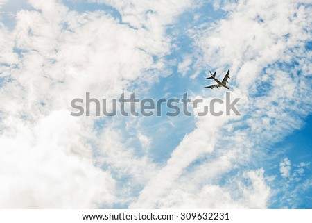 Airplane in sky. Image with selective focus - stock photo
