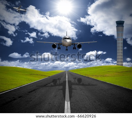 Airplane in the airport in the green field - stock photo