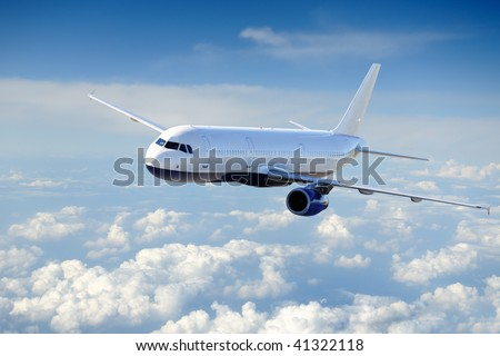 Airplane in the cloudy sky - Passenger Airliner / aircraft - stock photo