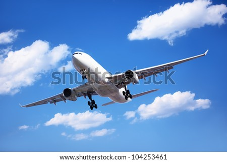 Airplane in the cloudy sky,Passenger Airliner Arrival. - stock photo