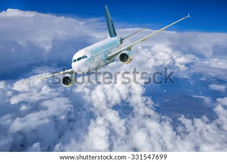 Airplane in the sky against cloudy  - stock photo