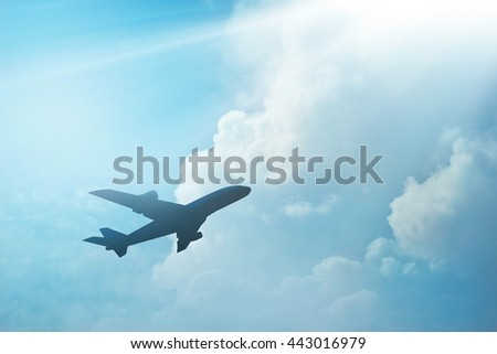 Airplane in the sky and cloud at sunset - stock photo