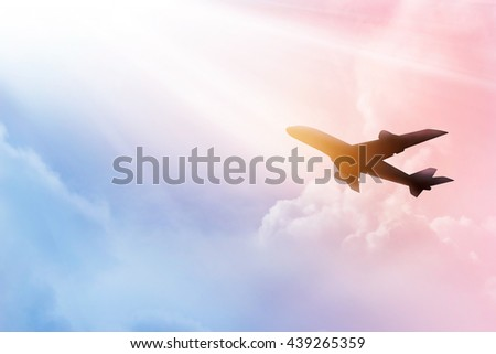 Airplane in the sky and cloud colorful at sunset