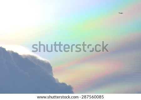 Airplane in the sky at rainbow - stock photo