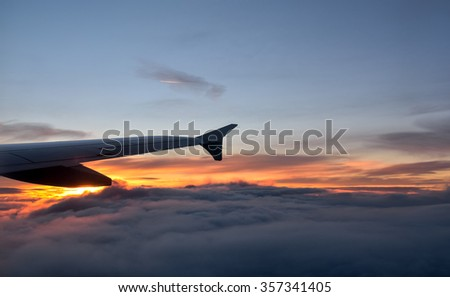 Airplane in the sky during sunset