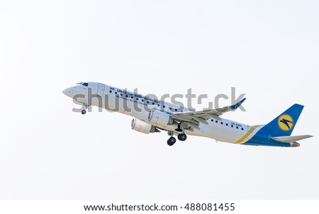 Airplane in the sky. Embraer ERJ-190LR (UR-EMD) by Ukraine International Airlines on the background of clear sky after take-off from airport Boryspil. Copy space. Boryspil, Ukraine - September 4, 2016