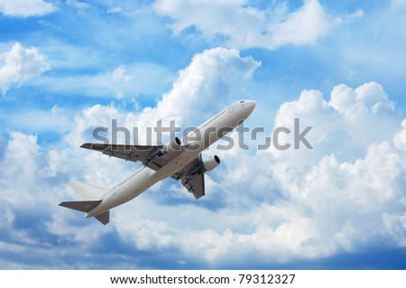 airplane in the sky full of fluffy clouds