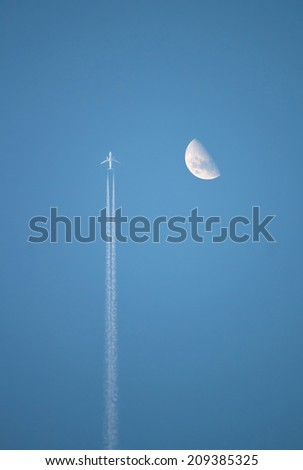Airplane in the sky near the moon - stock photo
