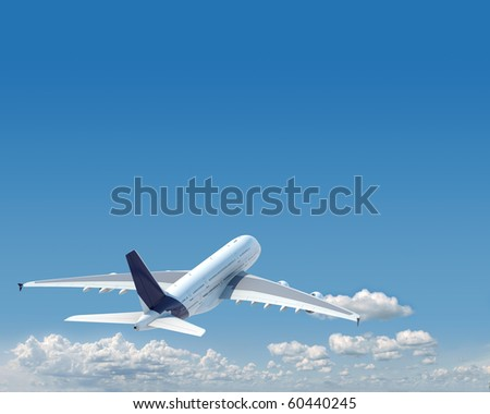 airplane in the sky seen from behind with copy space in the top and a clipping path in the plane - stock photo