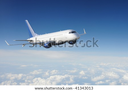 Airplane in the sky with clouds - stock photo