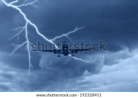 airplane in the sky with lightning - stock photo