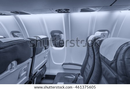 Airplane interior with view on New York City. Tourism and travel concept.