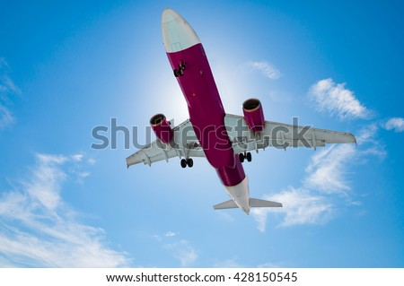 Airplane is about to landing on the airport with blue sky, Selective focus - stock photo