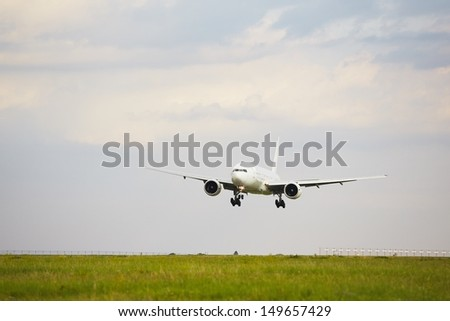 Airplane is landing on the airport - copy space