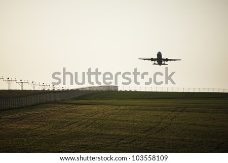 Airplane is leaving from Airport Prague, Czech Republic - stock photo
