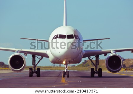 Airplane is taxiing to take off - retro colors - stock photo