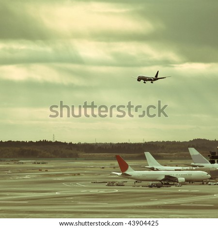 airplane is waiting for departure in pudong airport shanghai china. - stock photo