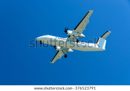 airplane isolated on blue sky background - stock photo