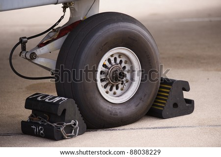 Airplane landing gear wheel - stock photo