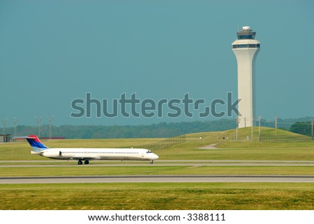 Airplane Landing In Front Of The Control Tower - Cincinnati Northern KY International Airport, CVG - stock photo